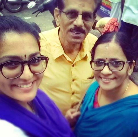 Parvathy with father and mother