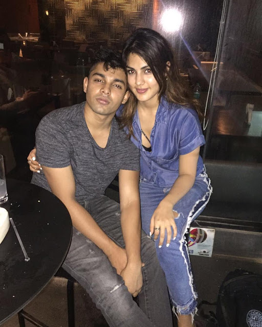 Rhea with brother Showik