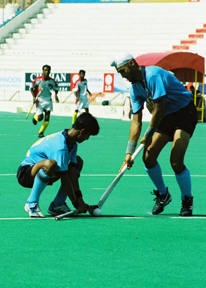 Sandeep Singh drag flicking the ball