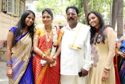 Srinidhi with her family
