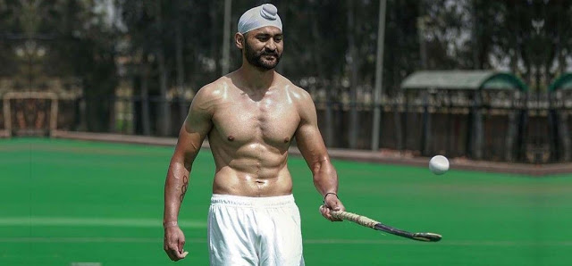 Sandeep Singh juggling the ball with a hockey stick