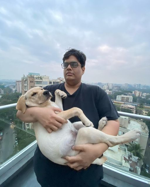 Tanmay Bhat with his dog in his terrace
