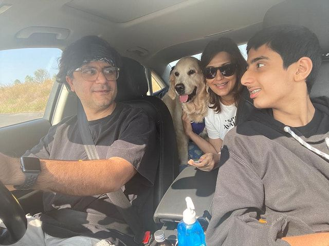 Sonali Bendre with her husband and son in a car